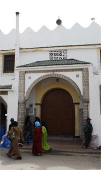 Mosque with abrown door