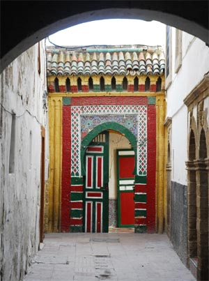 Green, red and white door
