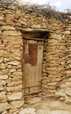 Old stonehouse with  wooden door